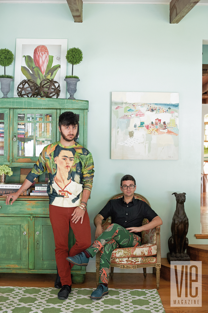 Christian Siriano and Brad Walsh posing in front of paint by Charleston artist Teil Duncan Connecticut Home Bed Bath and Beyond floral print design interior