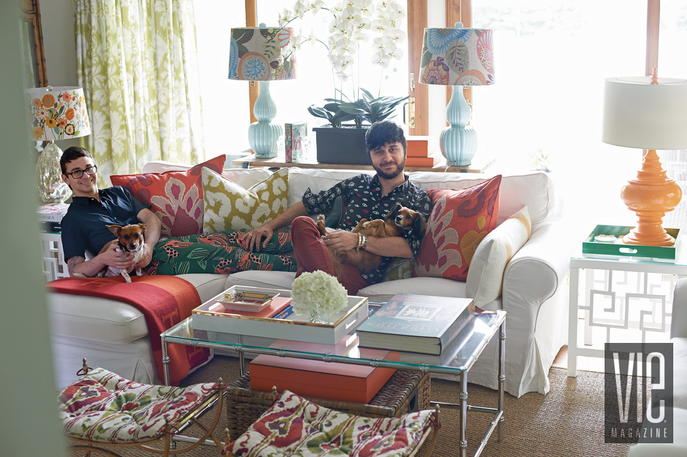 Christian Siriano and Brad Walsh posing in their living room with dogs Connecticut Home Bed Bath and Beyond floral print design interior