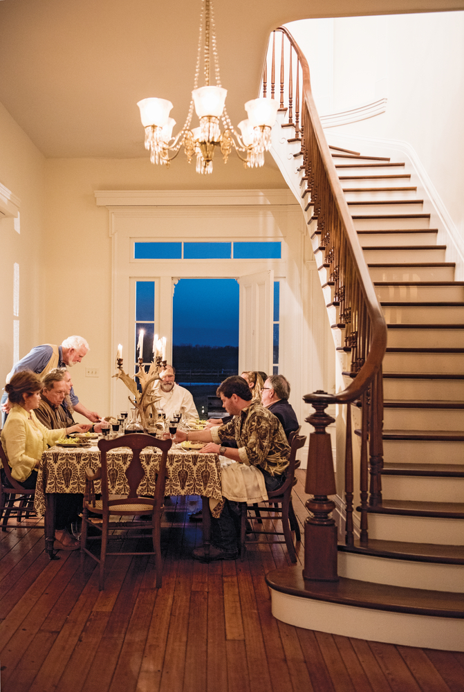 Julia Reed: At Home in the South dinner table setup in foyer under the staircase