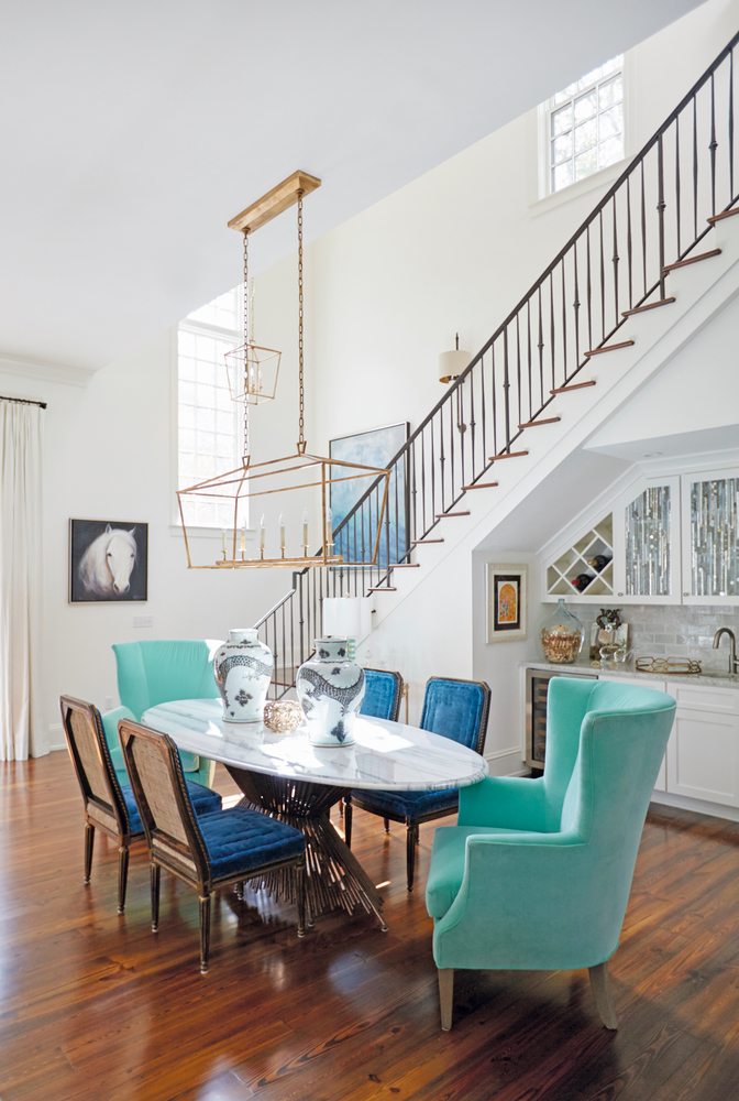 Susan Lovelace Destin Home dining table blue chairs staircase