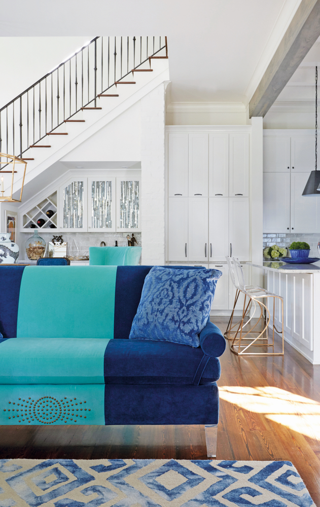 Susan Lovelace Destin home interior design blue striped couch staircase