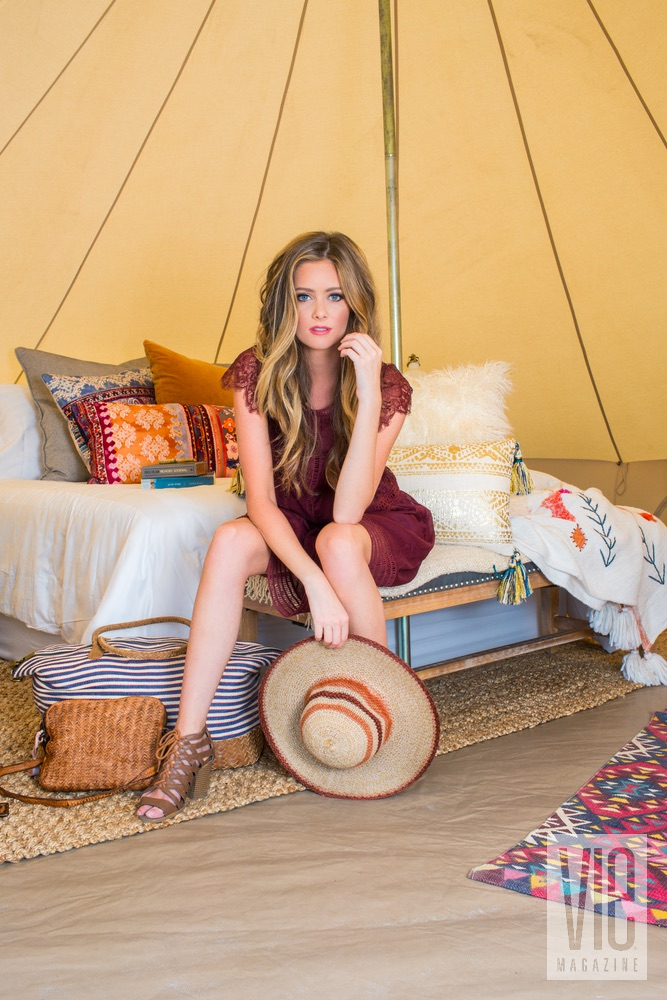 Model inside of the tent with her hat Fancy Camps glamping VIE magazine outdoors