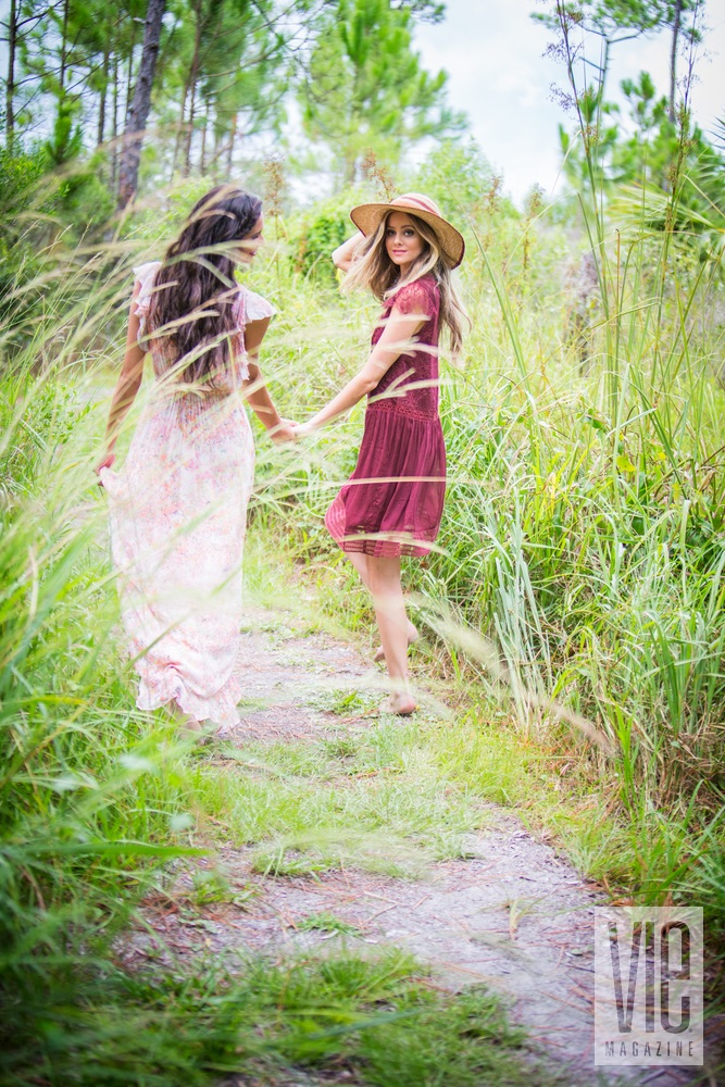 Models walking down a trail Fancy Camps VIE magazine glamping