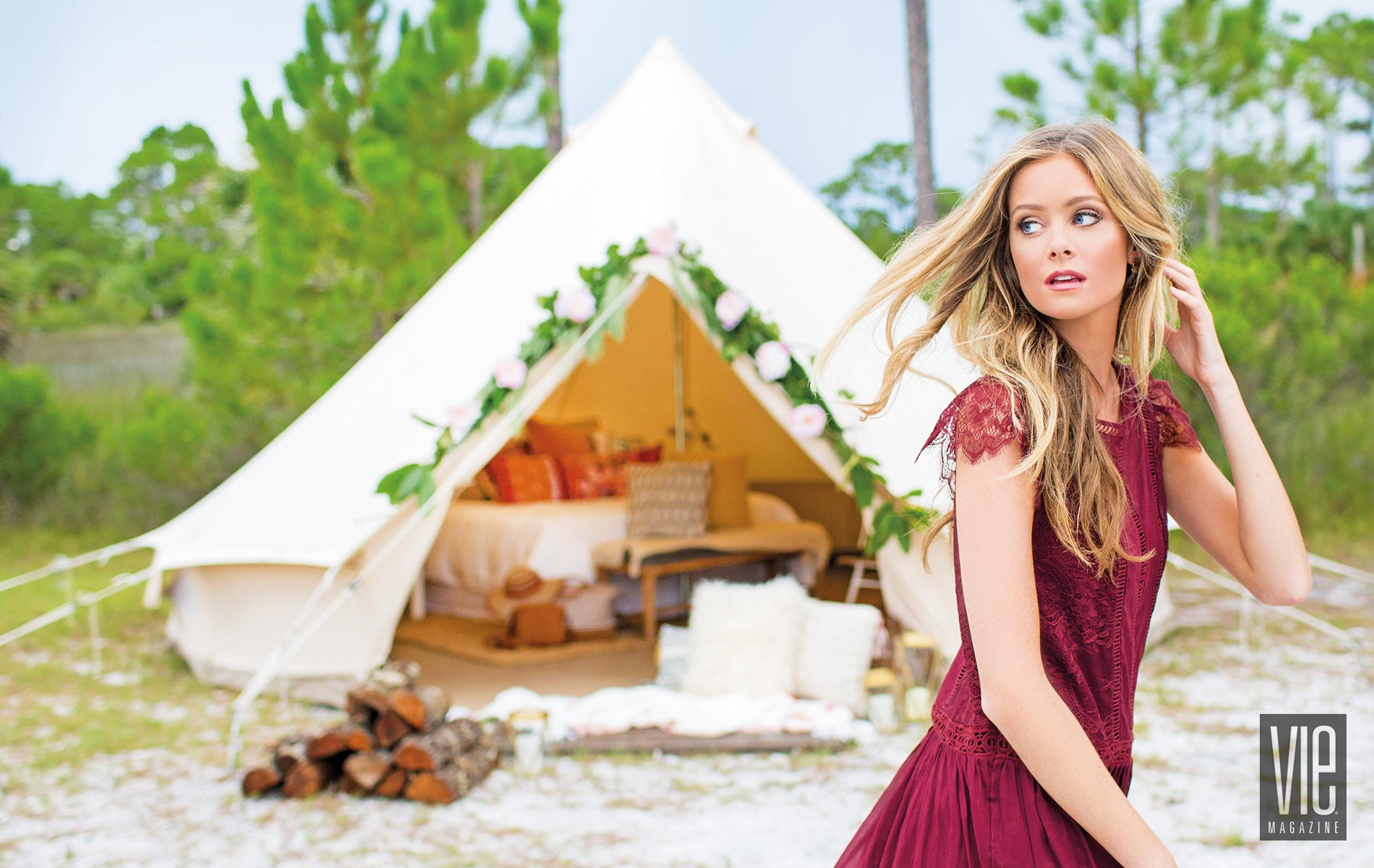 Model standing in front of a Fancy Camps tent glamping luxurious camping