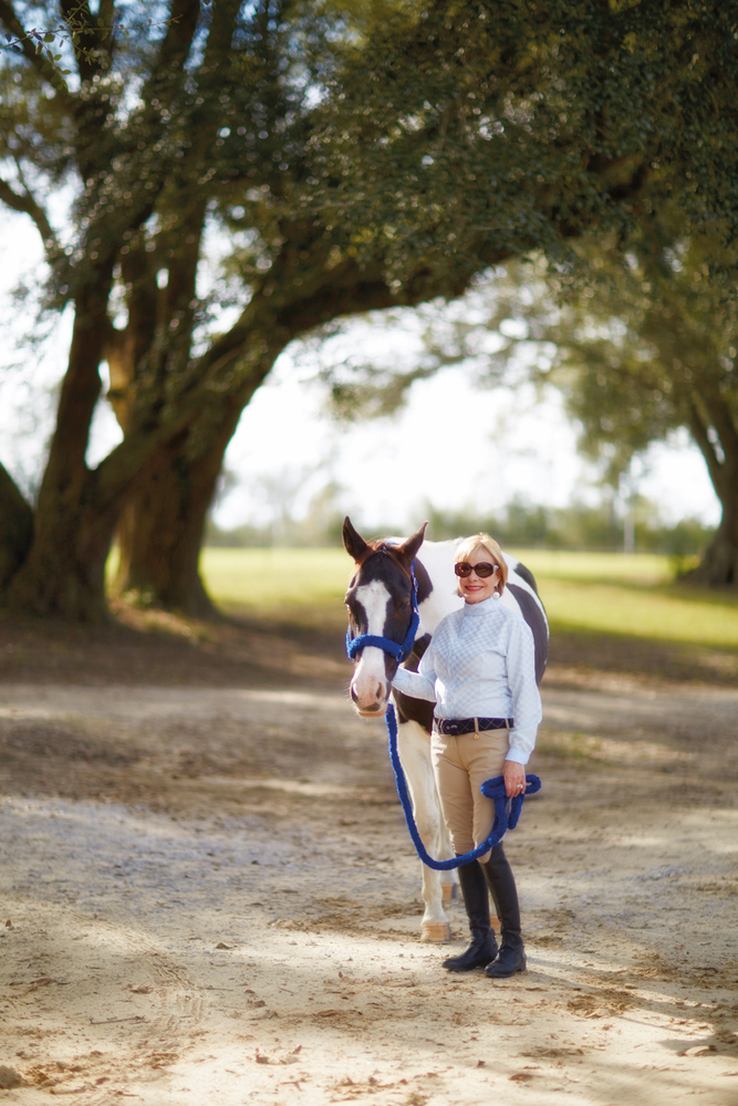 Susan Lovelace with her horse at her farmhouse interior design
