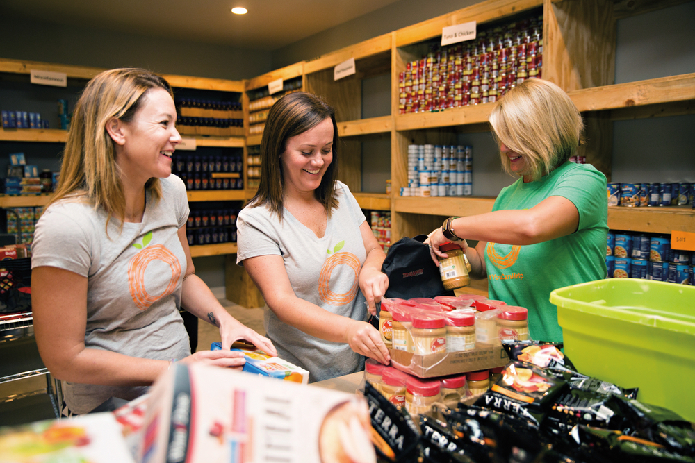 Volunteers stock the pantry for Food for Thought Outreach, Inc. near Destin, Florida.