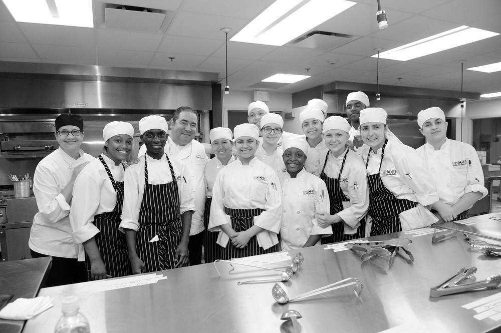 Chef Emeril and students participate in a kitchen training program supported by the Emeril Lagasse Foundation.