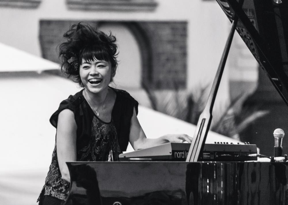 Hiromi Uehara Japanese Jazz Pianist playing a concert