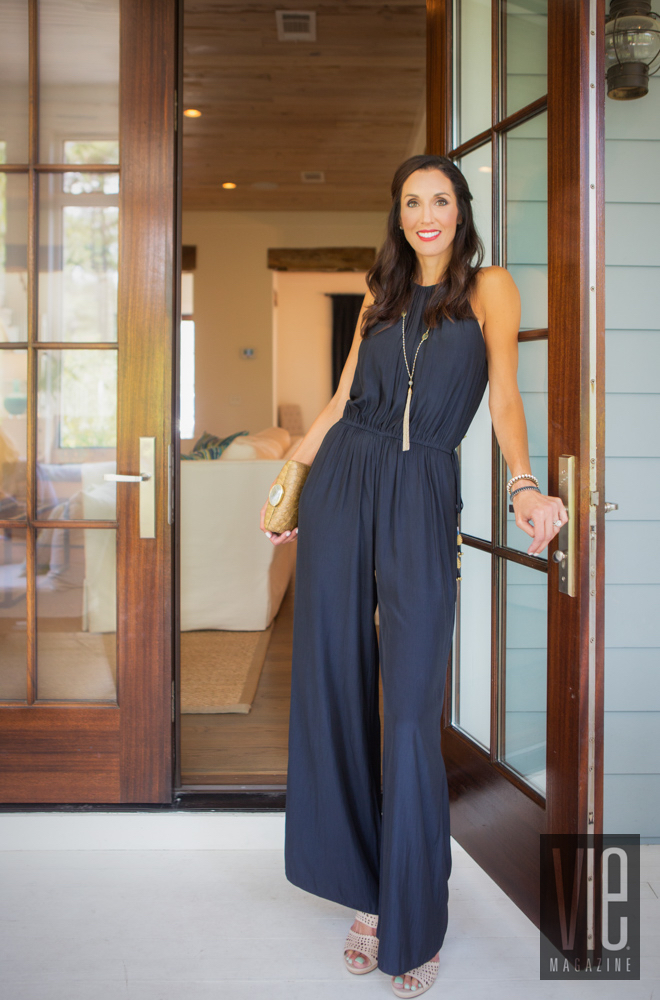 Women modeling black romper