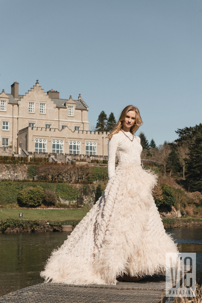 Irish model Clara McSweeney in front of Ballynahinch Castle in Christian Siriano gown