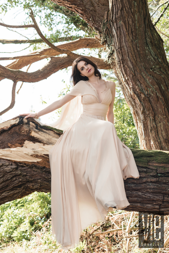 Irish model Faye Dinsmore sitting in a tree in a Christian Siriano gown at Ballynahinch Castle