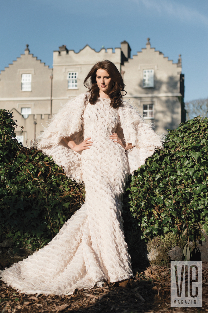 Irish model Faye Dinsmore standing in front of Ballynahinch Castle in Christian Siriano gown