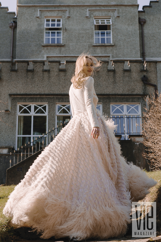 Irish model Clara McSweeney running up stairs at Ballynahinch Castle in Christian Siriano gown