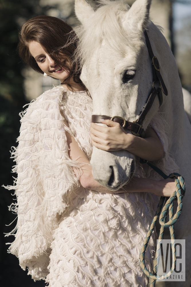 Faye Dinsmore and her white horse at Ballynahinch Castle The Sophisticate Issue 2016