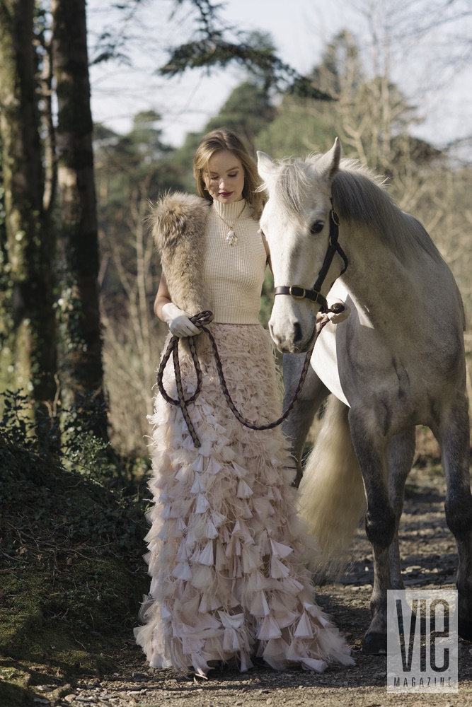 Clara McSweeney walking with her beautiful white Connemara pony at Ballynahinch Castle