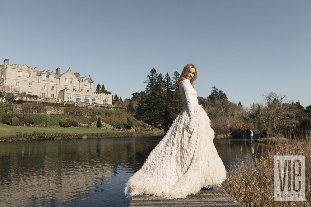 Clara McSweeney modeling in front of Ballynahinch Castle Christian Siriano gown