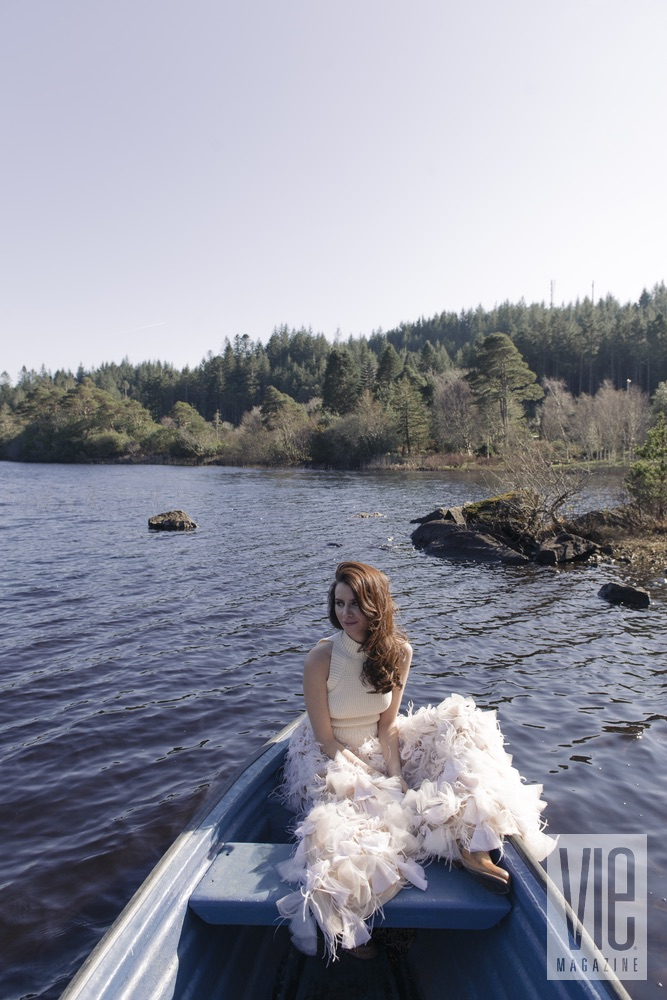 Faye Dinsmore in a boat at Ballynahinch Castle Christian Siriano gown