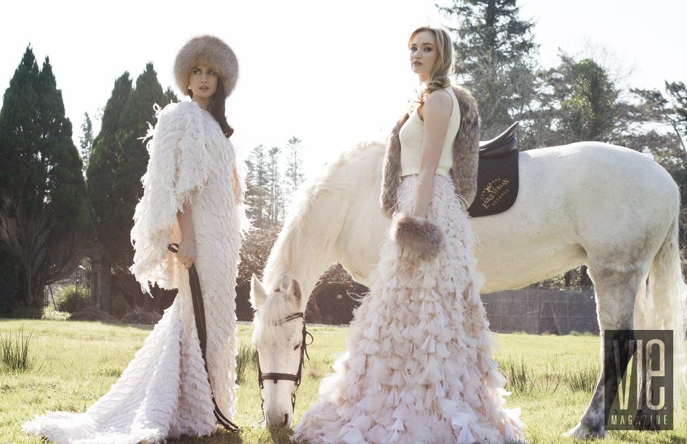 Clara McSweeney and Faye Dinsmore with their white horse at Ballynahinch Castle