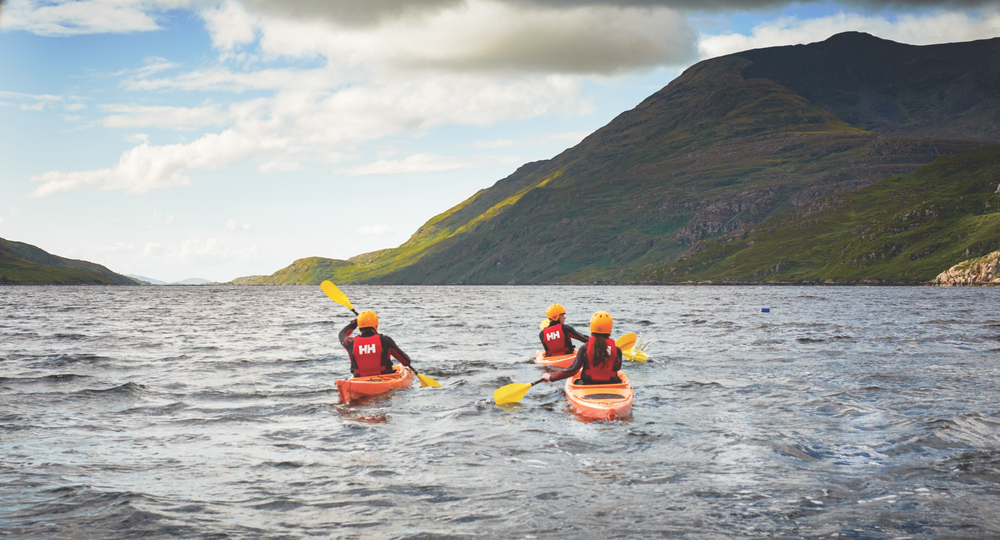 Group kayaking in lake in Western Ireland