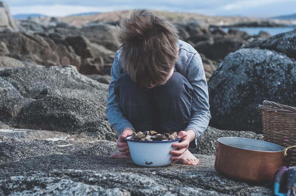 Cliodhna's son helping her cook Western Ireland Breaking Eggs Connemara Life