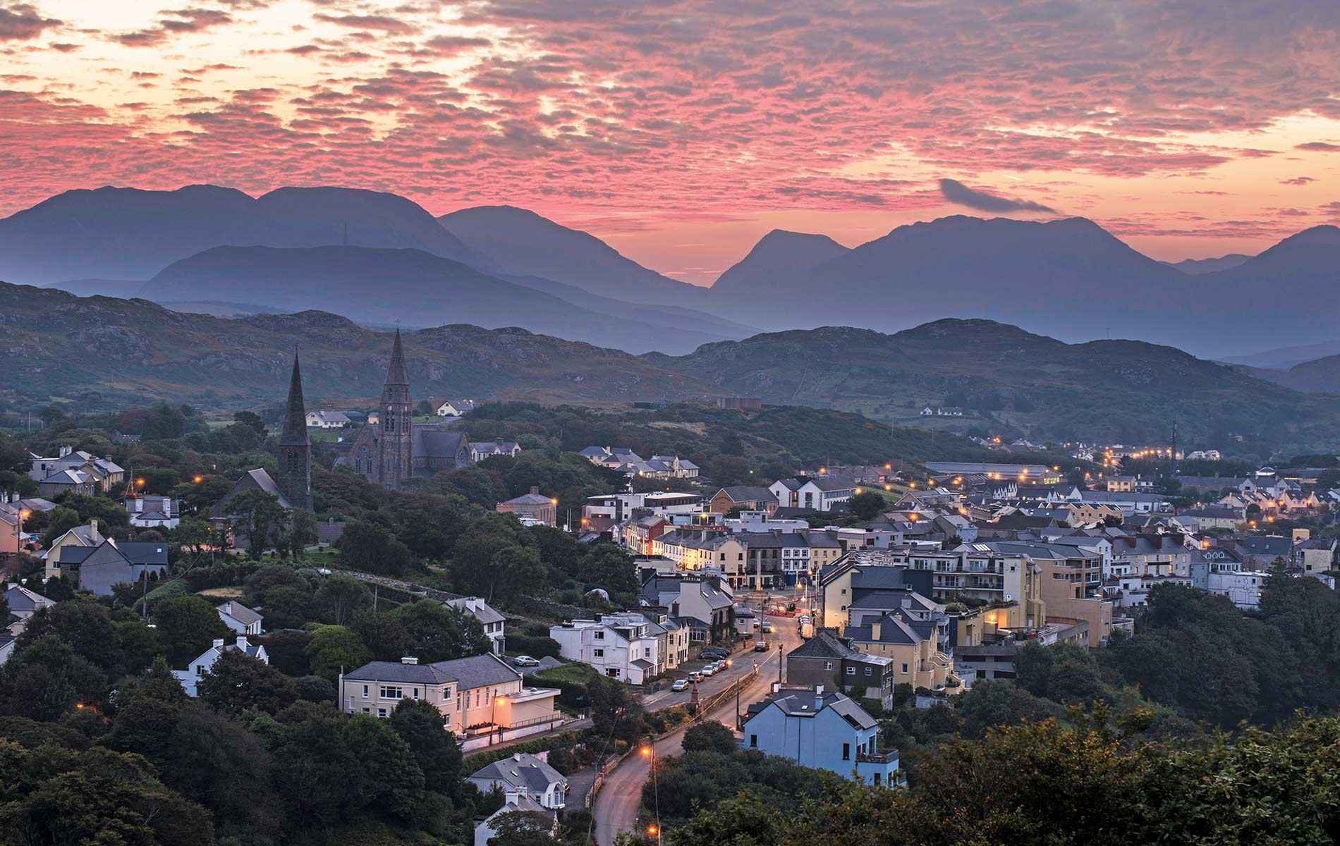 A view of the quaint town of Clifden in County Galway at sunrise, as seen from the nearby scenic Sky Road