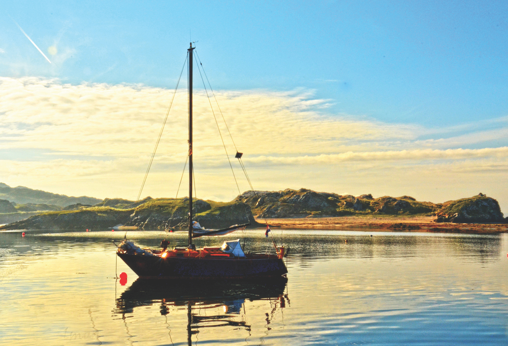 The serenity of a safe harbor reflects the island's beauty in Inishbofin Ireland