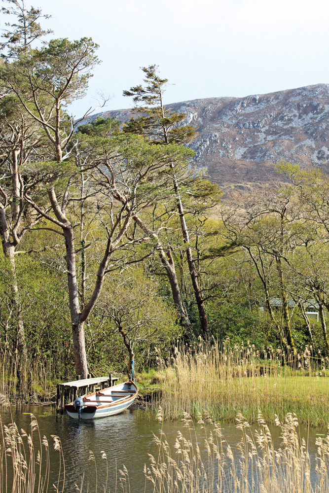 Boat by Kylemore Abbey with mountain in background Connemara Life 2016