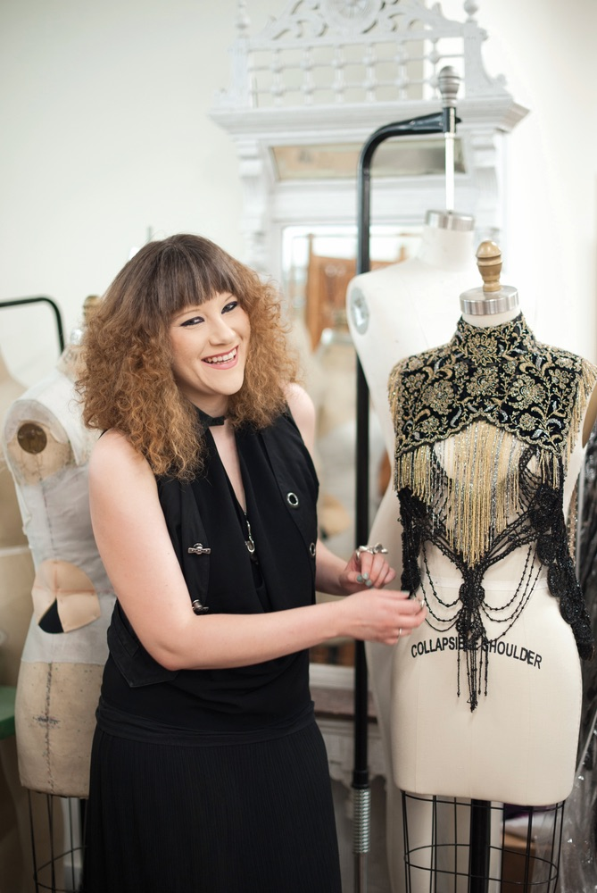 Designer Mimi Prober with one of her creations hand made detailed fashion Sophisticate 2016