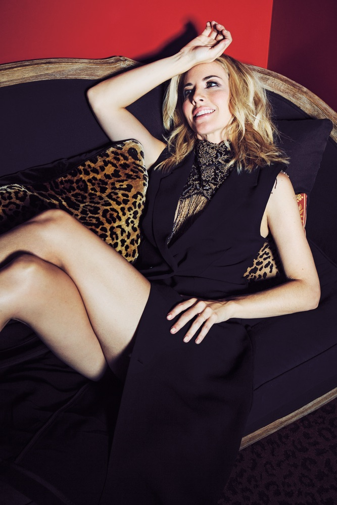 The beautiful Morgan James draped over a chair in a Mimi Prober gown