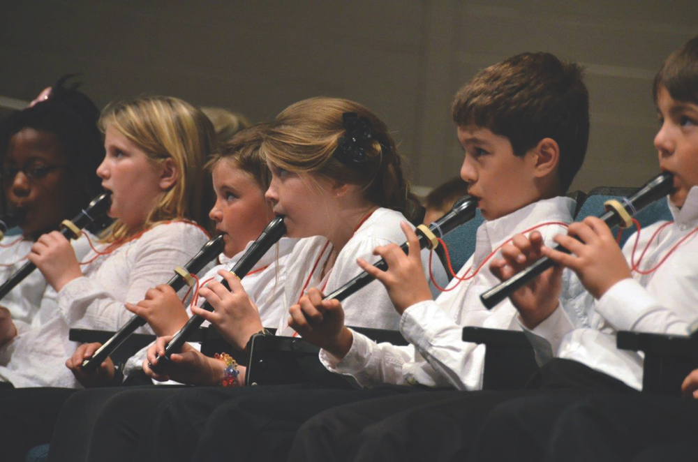 Kids learning clarinets at the Sinfonia Education Program