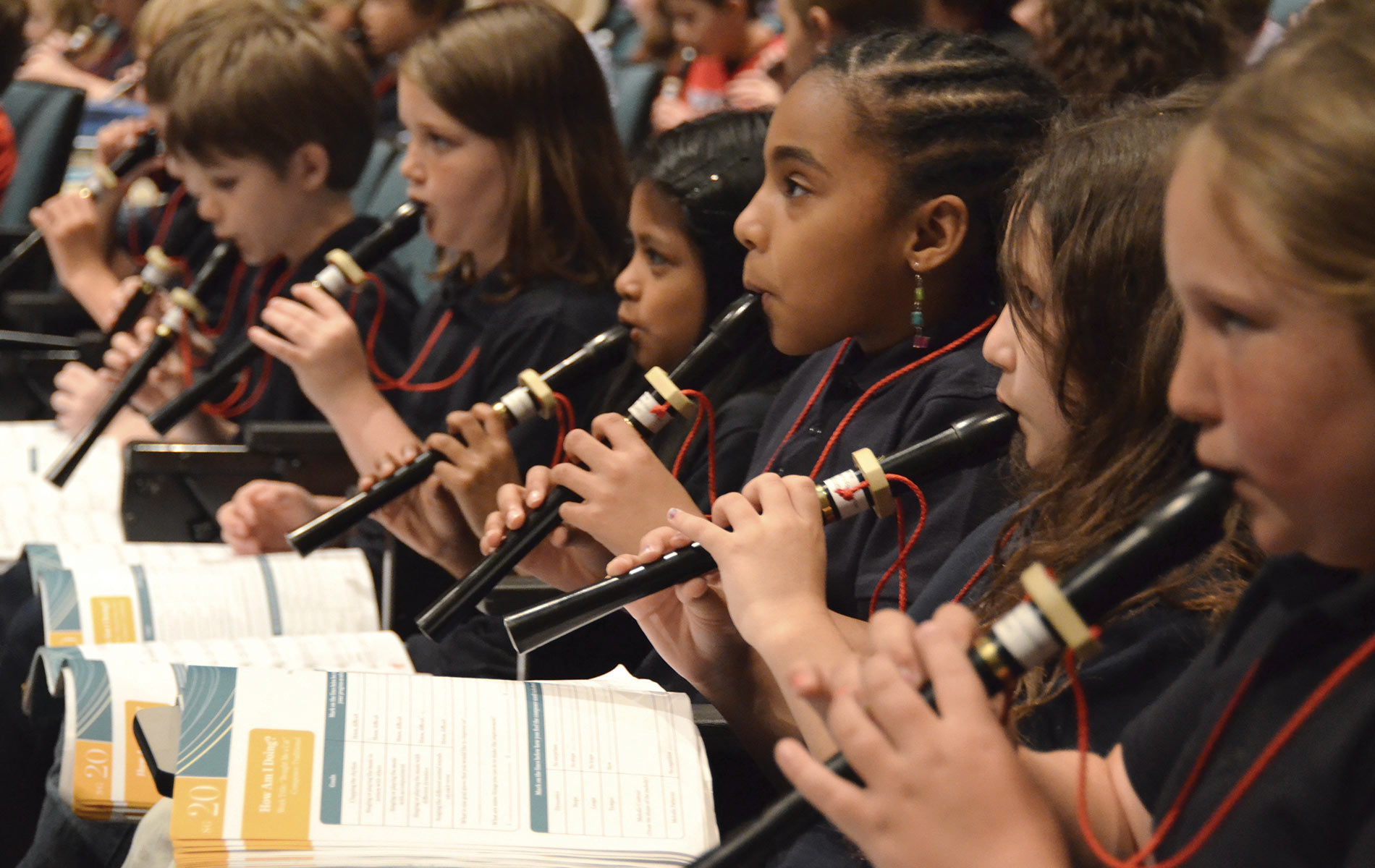 Sinfonia education program students learning how to play clarinets
