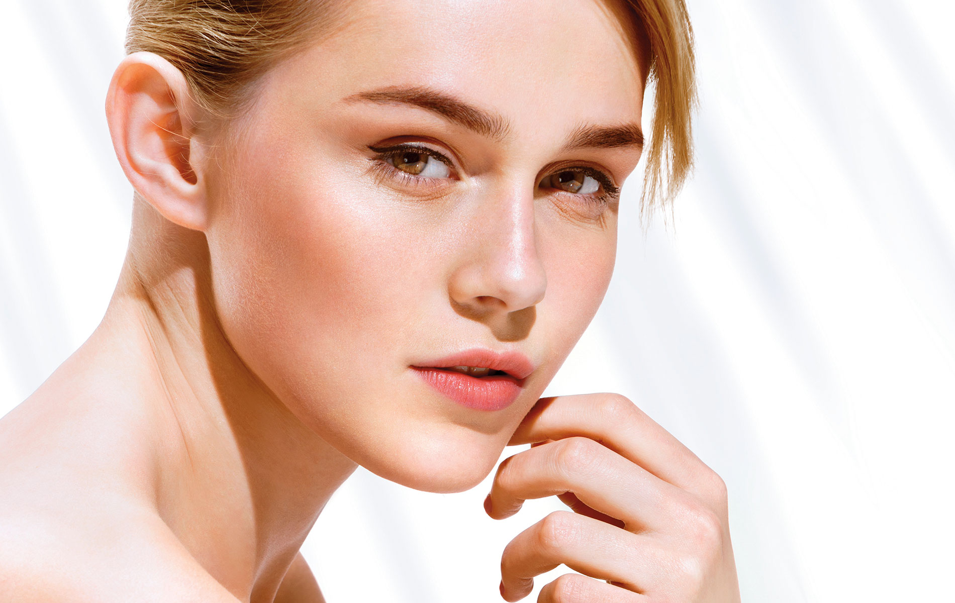 Young woman with beautiful healthy glowing skin Aesthetic Clinique VIE magazine