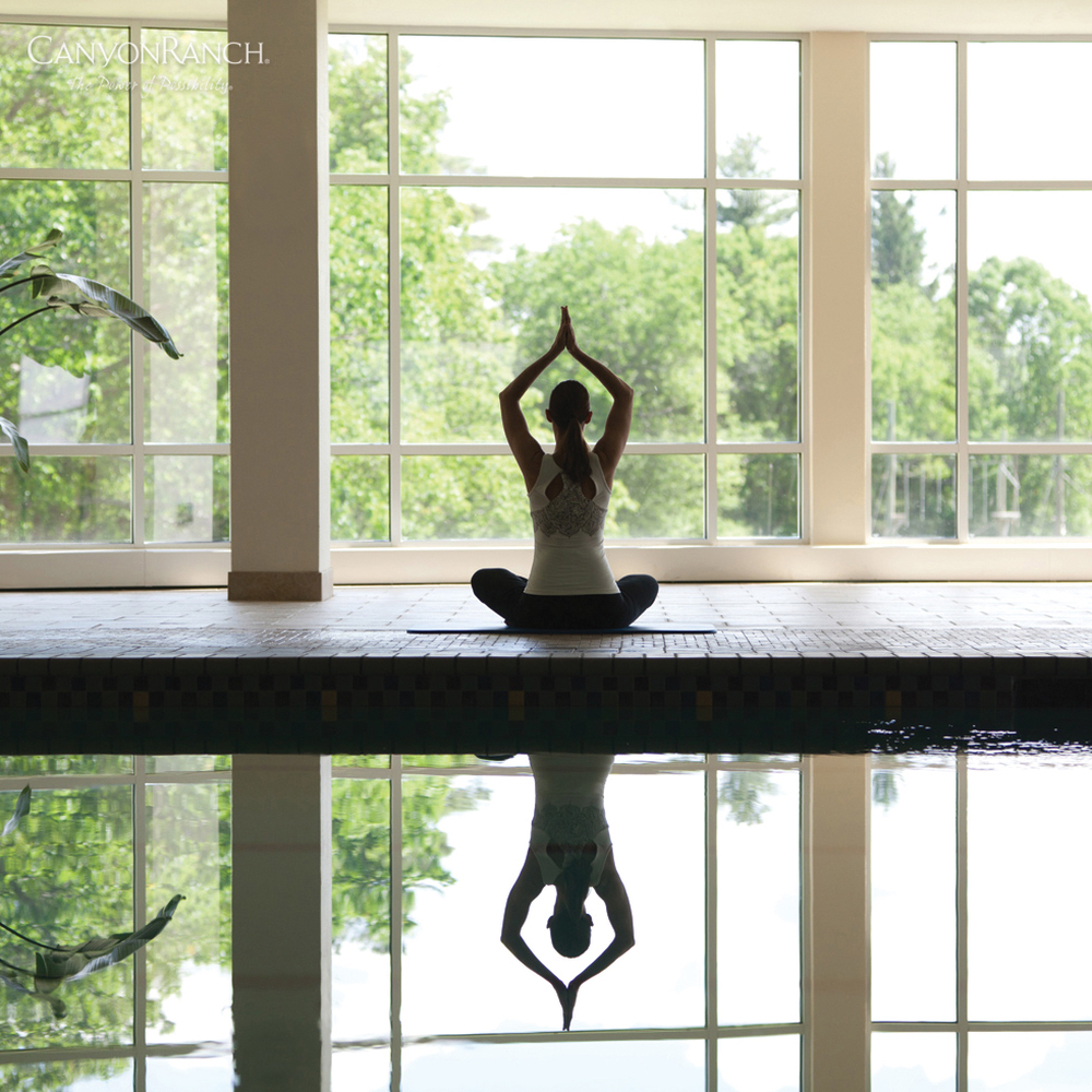 Woman doing yoga at indoor pool at Canyon Ranch Resort & Spa Lenox, in Massachusetts, USA