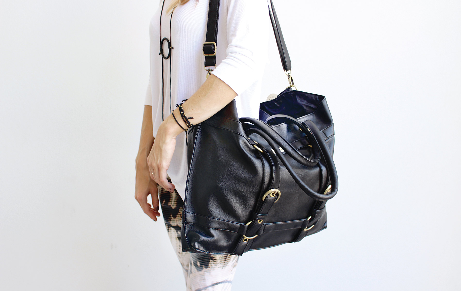 The Be Great shoulder bag by Maha Loka model with shoulder bag on white background