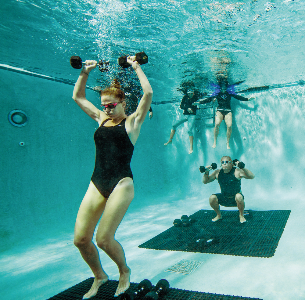 Underwater exercise with weights fitness healthy lifestyle VitalityPro