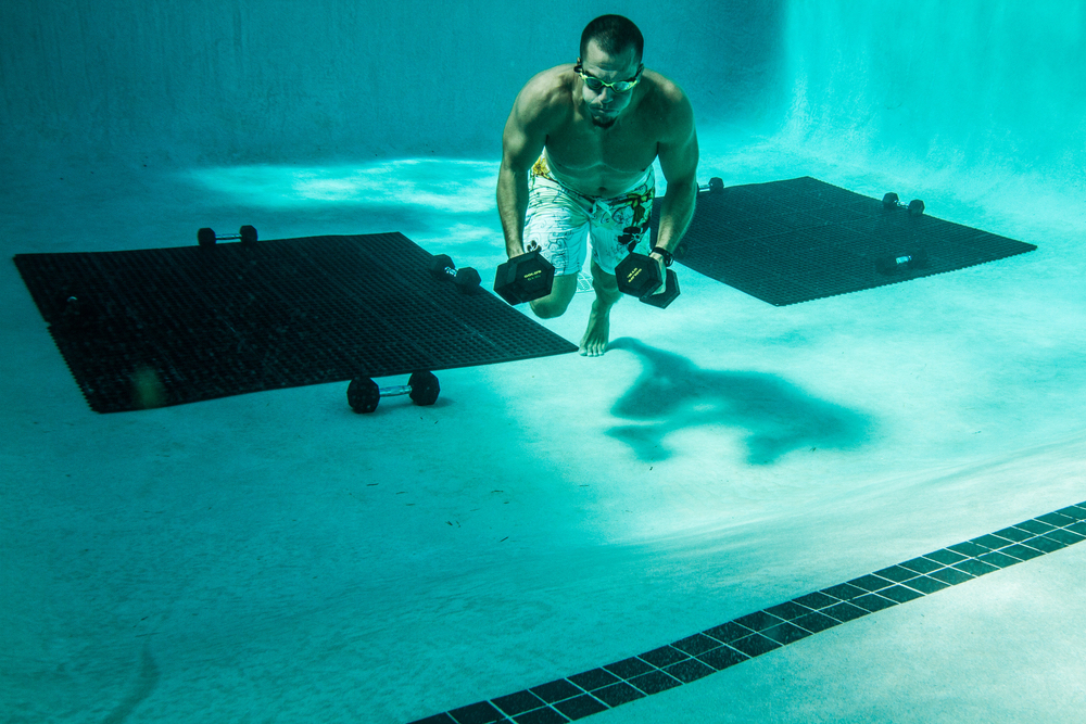 Man swimming with weights VitalityPro exercise healthy living