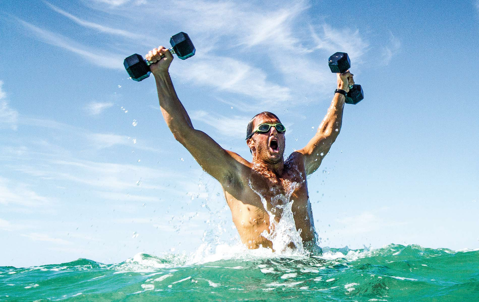 Vitality Pro man coming out of the water with weights exercise healthy living