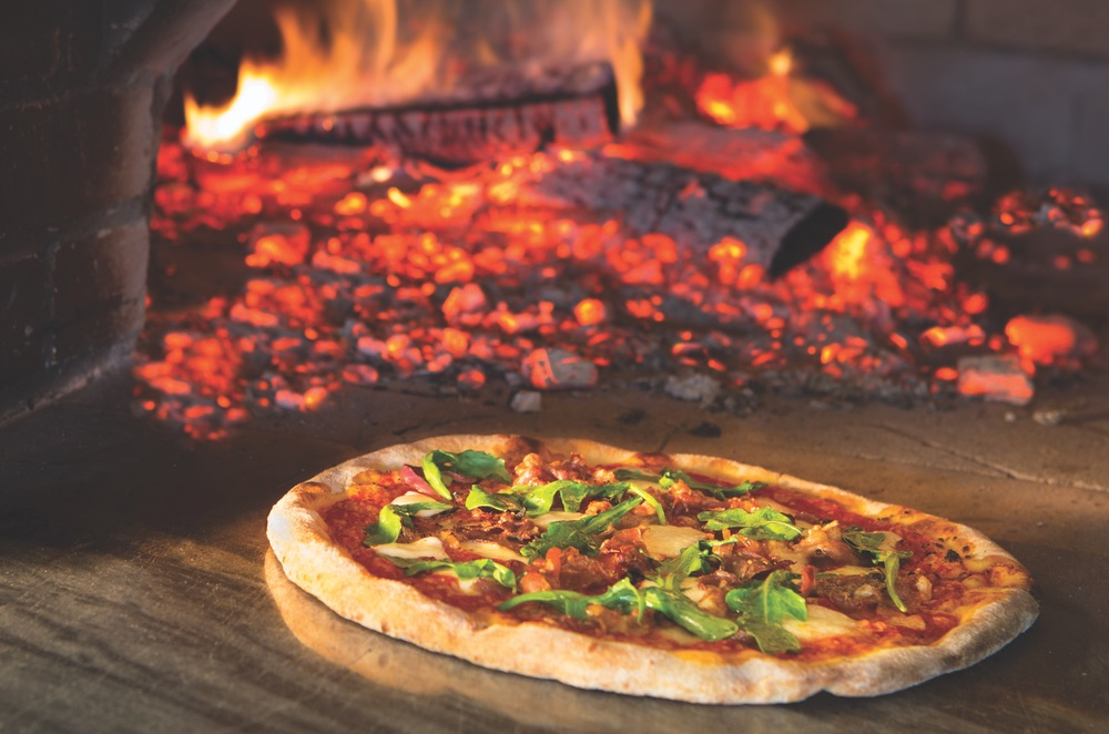 Wood-fired brick oven pizza served at the Acme Ice House, The Village at Seacrest Beach on Scenic Highway 30-A