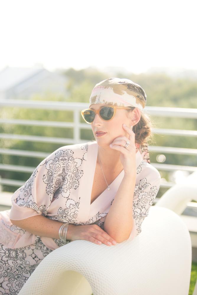 Stairway to Heaven, Ruskin Place, Seaside Florida. Kimono by BCBG MaxAzria Sunglasses by Ralph Lauren Jewelry courtesy of Reeds Jewelers Scarf from Ophelia Swimwear
