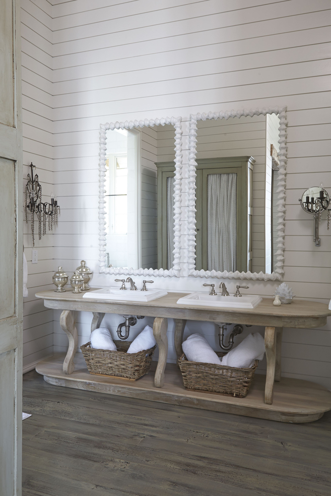 Detail shot of the double sinks and mirrors Lake Martin home bathroom