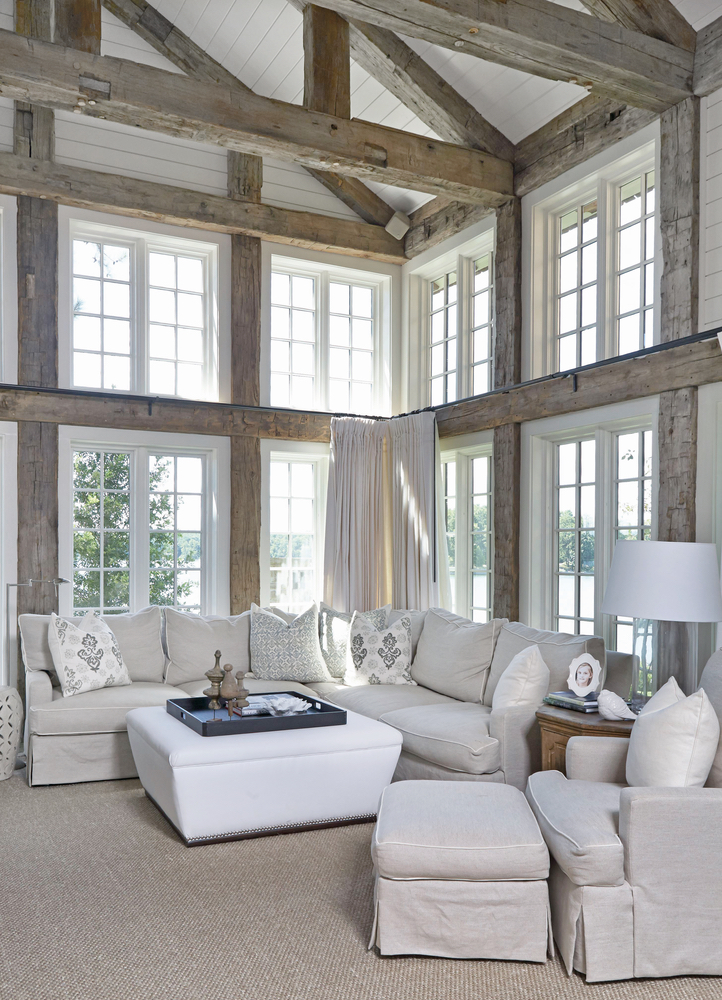 Living area with lots of windows for natural lighting in Lake Martin Home