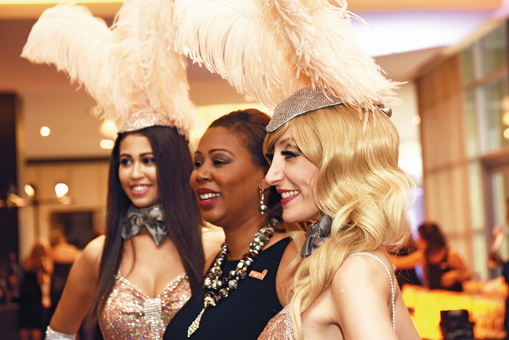 Showgirls mingle with dinner guests at Carnivale du Vin in NOLA