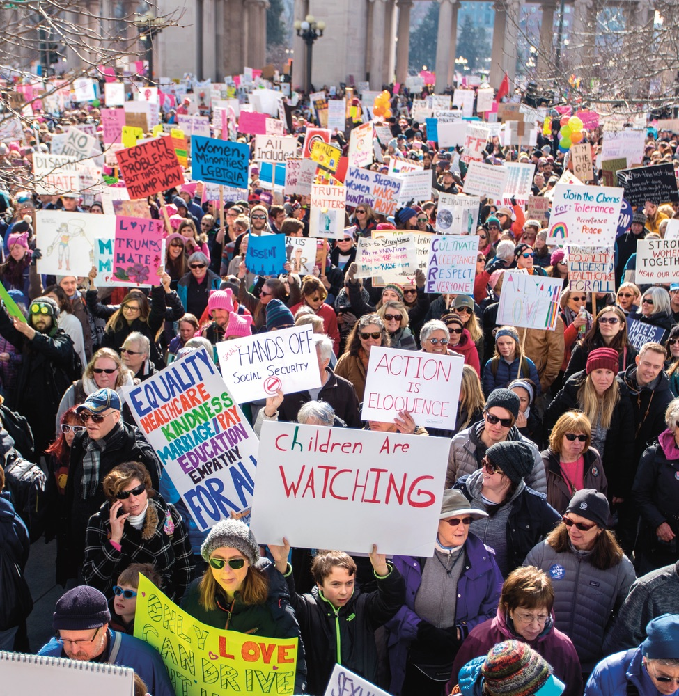 More than a hundred thousand protestors march in downtown Denver in the Women's March on January 21, 2017, one day after President Trump's inauguration. Photo by Andrew Repp/Shutterstock.