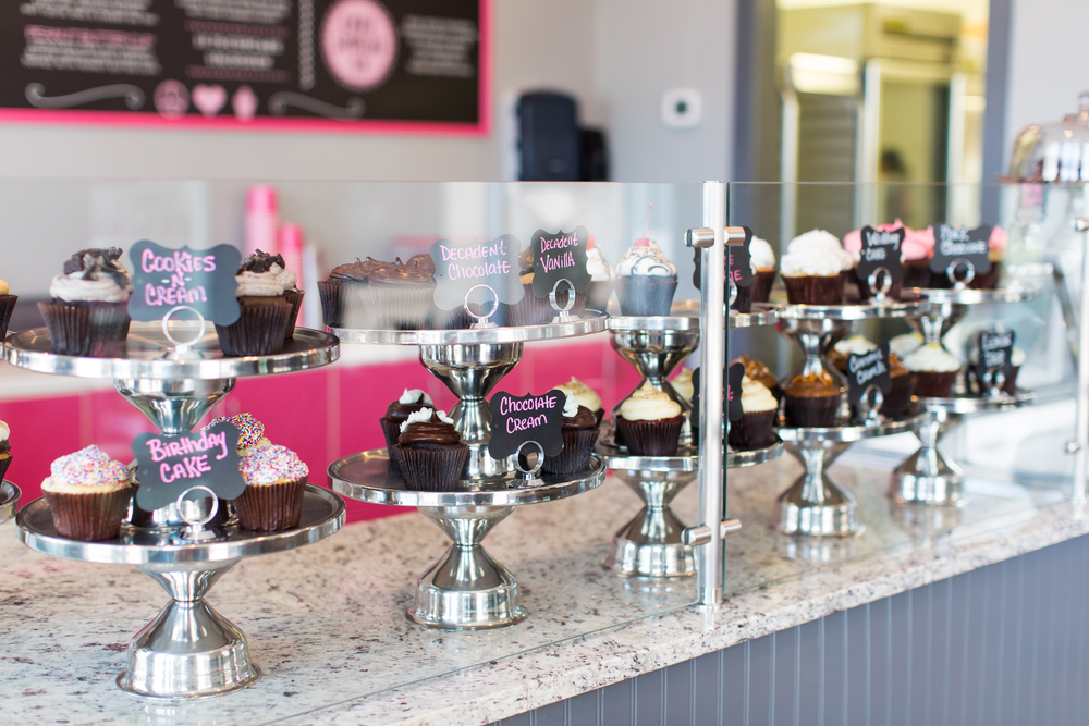 Smallcakes Cupcakery and Creamery displaying cupcakes on counter.