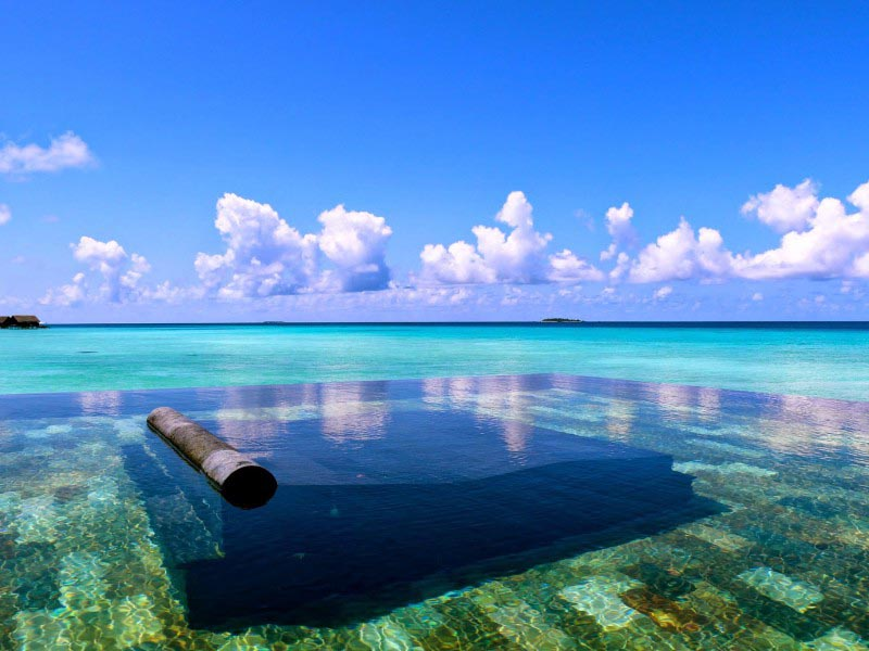 One&Only Reethi Rah in Maldives resort pool with beach view