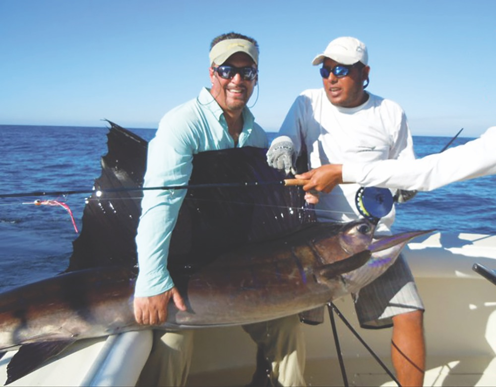 Author Darin Colucci (left) with his prized catch during a sailfish tournament in Guatemala