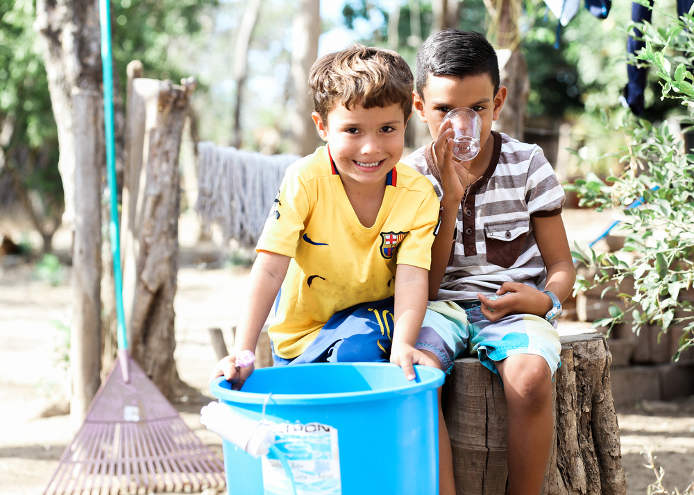 Kids playing and drinking clean water Filter of Hope Nicaragua