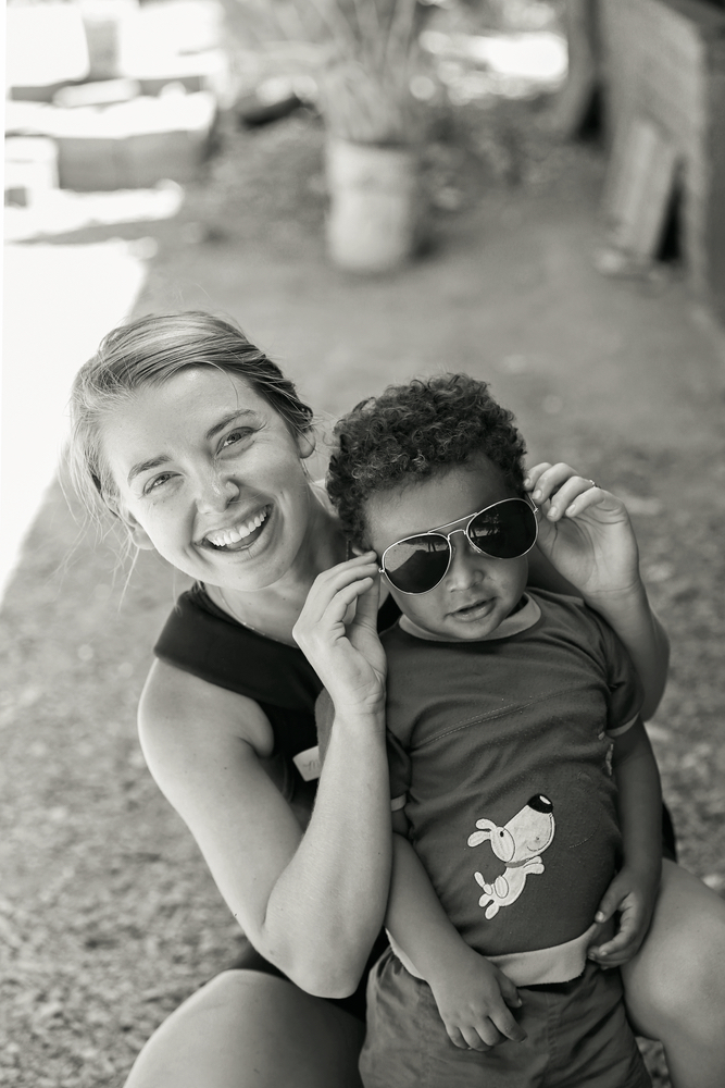 Author Meghan Ryan playing with a child in Nicaragua Filter of Hope clean water