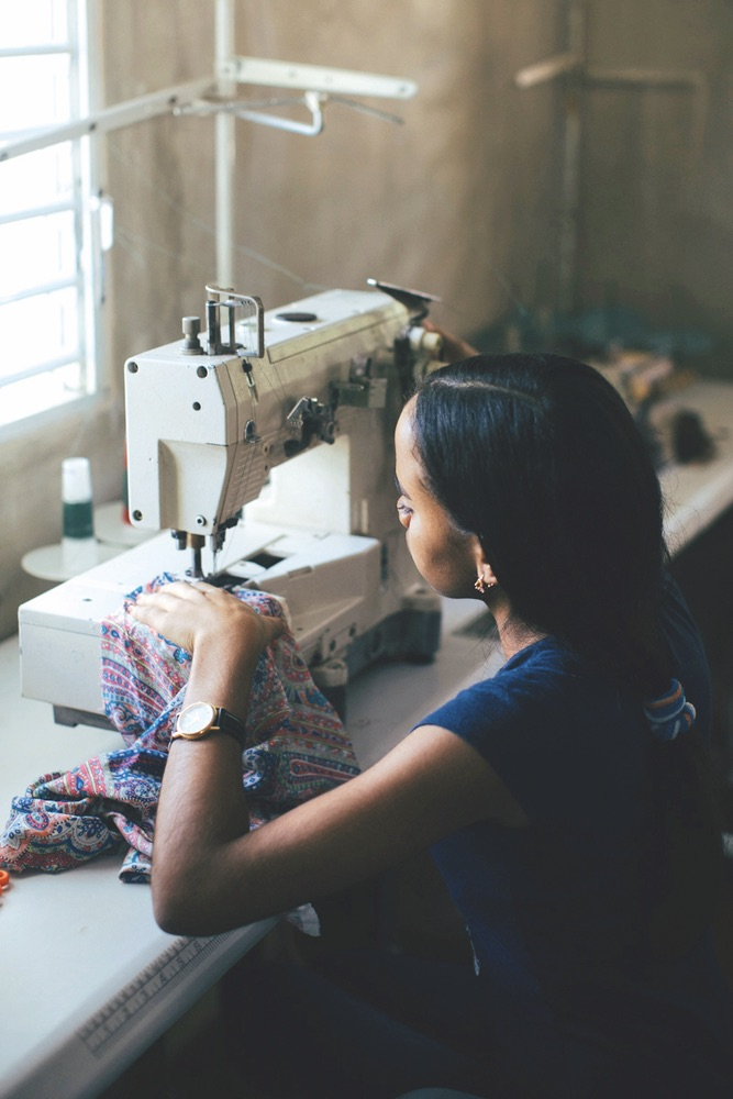 Girl working with sewing machine, OKO Lifestyle