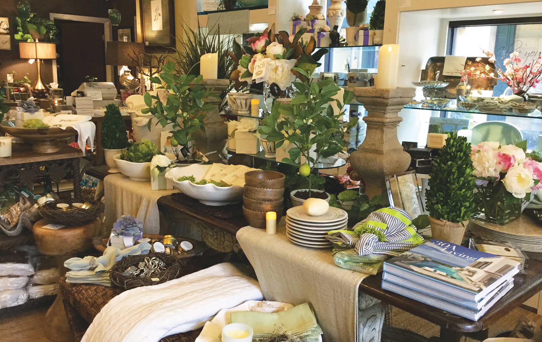 Magnolia House Lifestyle Store, located in the Grand Boulevard Town Centre in Miramar Beach, Florida, offers home decor, books, original artwork, and much more.